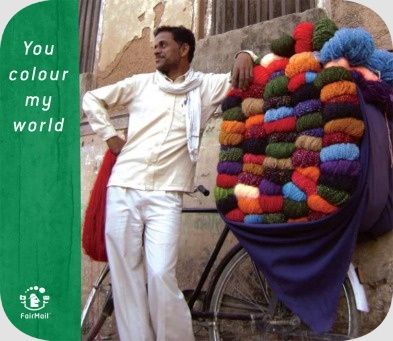 Fair Trade Photo Greeting Card Activity, Asia, Asian, Bicycle, Casual clothing, Clothing, Colour image, Dailylife, Day, Entrepreneurship, Friendship, India, Looking away, Love, Multi-coloured, One man, Outdoor, People, Portrait fullbody, Pride, Selling, Street, Streetlife, Transport, Vertical, Wool