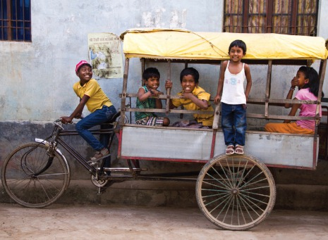 Fair Trade Photo Greeting Card 5_-10_years, Activity, Asia, Asian, Bicycle, Casual clothing, Clothing, Colour image, Day, Friendship, Group of children, Horizontal, India, Outdoor, People, Playing, Portrait fullbody, Riksja, Smiling, Transport, Travel