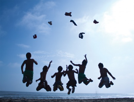 Fair Trade Photo Greeting Card Activity, Backlit, Beach, Colour image, Cooperation, Emotions, Evening, Freedom, Friendship, Group of boys, Happiness, Jumping, Outdoor, People, Peru, Playing, Silhouette, Sky, South America, Sunset, Throwing, Together