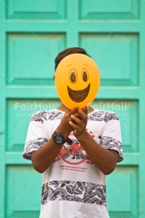 Fair Trade Photo Activity, Balloon, Birthday, Colour image, Colourful, Congratulations, Emotions, Face, Food and alimentation, Friendship, Fruits, Green, Happiness, Happy, One boy, One person, Orange, Outdoor, Party, People, Peru, Red, Smile, Smiling, South America, Vertical