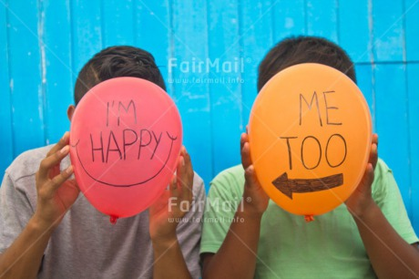 Fair Trade Photo Balloon, Blue, Colour image, Colourful, Emotions, Food and alimentation, Friendship, Fruits, Happiness, Happy, Horizontal, Letter, Orange, Outdoor, People, Peru, Red, Smile, South America, Text, Two, Two boys, Two people