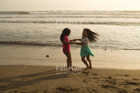 Fair Trade Photo 10-15_years, 5_-10_years, Activity, Beach, Children, Colour image, Dancing, Day, Emotions, Evening, Friendship, Happiness, Holding hands, Holiday, Horizontal, Ocean, People, Peru, Playing, Sand, Sea, Seasons, Sister, South America, Summer, Twins, Two, Water