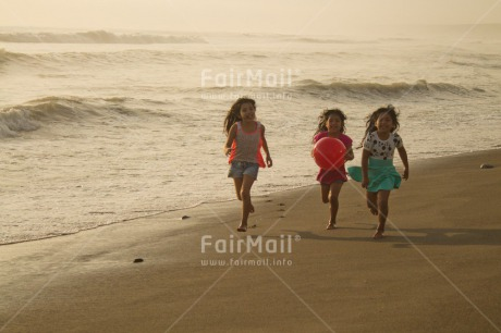 Fair Trade Photo 10-15_years, 5_-10_years, Activity, Ball, Beach, Children, Colour image, Day, Emotions, Evening, Friendship, Happiness, Holiday, Horizontal, Ocean, People, Peru, Playing, Running, Sand, Sea, Seasons, Sister, South America, Summer, Three, Twins, Water