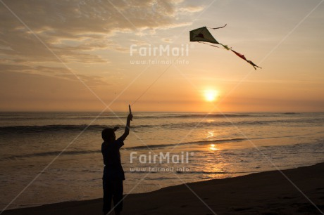 Fair Trade Photo Activity, Backlit, Beach, Clouds, Colour image, Evening, Freedom, Hope, Kite, One boy, Outdoor, People, Peru, Playing, Sea, Silhouette, Sky, South America, Summer, Sunset, Water