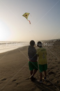Fair Trade Photo Activity, Backlit, Beach, Clouds, Colour image, Evening, Freedom, Friendship, Hope, Kite, Outdoor, People, Peru, Playing, Sea, Silhouette, Sky, South America, Summer, Sunset, Together, Two boys, Water
