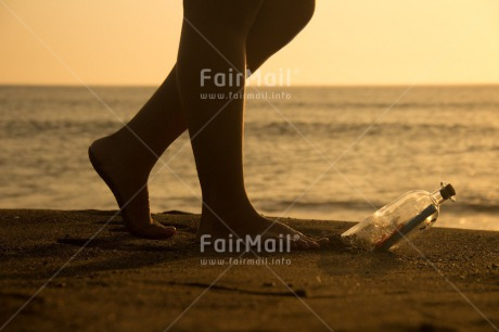 Fair Trade Photo Activity, Barefeet, Beach, Bottle, Coastal, Colour image, Emotions, Evening, Feet, Footstep, Horizontal, Huanchaco, Loneliness, Message, Ocean, Outdoor, People, Peru, Sand, Sea, South America, Sunset, Walking, Water