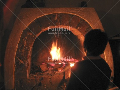 Fair Trade Photo Activity, Colour image, Condolence, Emotions, Evening, Fire, Fireplace, Horizontal, Indoor, Miss you, One boy, People, Peru, Sadness, Sitting, Sorry, South America, Thinking of you