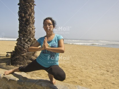 Fair Trade Photo 15-20_years, Activity, Beach, Casual clothing, Clothing, Colour image, Day, Horizontal, Latin, One girl, Outdoor, People, Peru, Sand, Seasons, South America, Summer, Tree, Wellness, Yoga