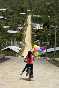 Fair Trade Photo Balloon, Bicycle, Birthday, Colour image, Emotions, Happiness, Latin, One girl, Outdoor, People, Peru, Rural, South America, Transport, Vertical