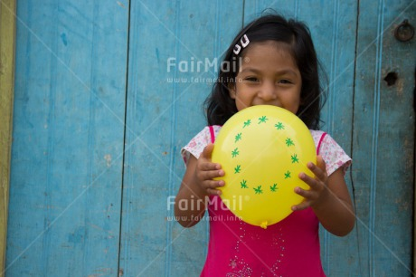 Fair Trade Photo 5_-10_years, Activity, Balloon, Birth, Birthday, Colour image, Horizontal, Latin, Looking at camera, New baby, One girl, People, Peru, Pink, Round, Smiling, South America, Yellow, Zero