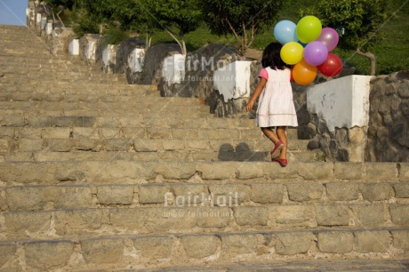 Fair Trade Photo Activity, Balloon, Birthday, Colour image, Confirmation, Day, Growth, Horizontal, One girl, Outdoor, Party, People, Peru, South America, Stairs, Summer, Walking