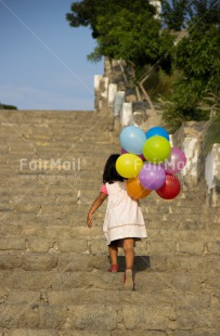 Fair Trade Photo Activity, Balloon, Birthday, Colour image, Confirmation, Day, Growth, One girl, Outdoor, Party, People, Peru, South America, Stairs, Summer, Vertical, Walking
