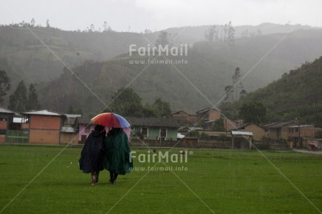 Fair Trade Photo Activity, Colour image, Friendship, Horizontal, Peru, Rain, Rural, Scenic, South America, Together, Umbrella, Walking