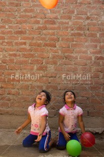 Fair Trade Photo Activity, Balloon, Colour image, Emotions, Friendship, Happiness, Party, People, Peru, Playing, Smiling, South America, Together, Twin, Two girls, Vertical