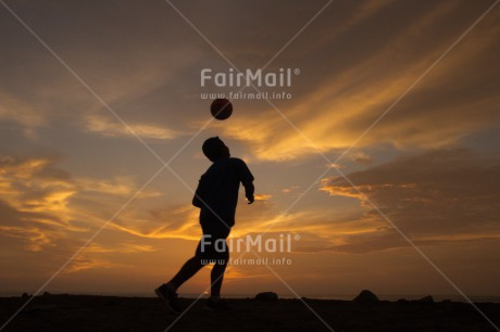 Fair Trade Photo Ball, Clouds, Colour image, Horizontal, One boy, Outdoor, People, Peru, Shooting style, Silhouette, Soccer, South America, Sport