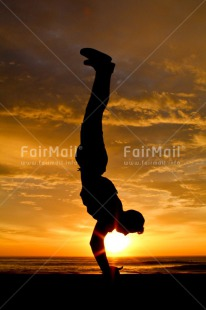 Fair Trade Photo Activity, Beach, Colour image, Colourful, Doing yoga, Emotions, Evening, Happiness, Light, One man, One person, Outdoor, People, Peru, Relax, Relaxing, Shooting style, Silhouette, Sky, South America, Strength, Success, Sun, Sunset, Vertical, Yoga