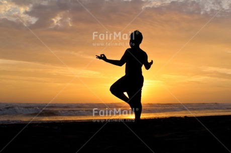 Fair Trade Photo Activity, Beach, Colour image, Colourful, Doing yoga, Emotions, Evening, Happiness, Horizontal, Light, One person, Outdoor, People, Peru, Relax, Relaxing, Shooting style, Silhouette, Sky, South America, Standing, Strength, Success, Sun, Sunset, Yoga