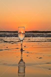 Fair Trade Photo Beach, Colour image, Food and alimentation, Fruits, Glass, Orange, Peru, Reflection, Sea, South America, Sunset, Vertical, Water