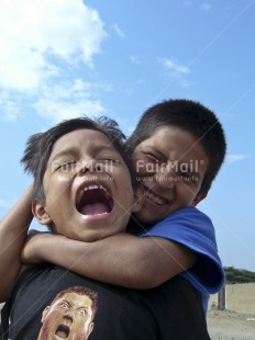 Fair Trade Photo 10-15_years, Activity, Colour image, Day, Emotions, Friendship, Funny, Happiness, Latin, Looking at camera, Outdoor, People, Peru, Playing, Portrait halfbody, Seasons, Sky, Smile, Smiling, South America, Summer, Together, Two boys, Two children, Vertical
