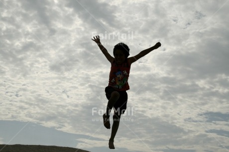 Fair Trade Photo Activity, Backlit, Clouds, Colour image, Emotions, Freedom, Happiness, Horizontal, Jumping, One boy, One child, People, Peru, Silhouette, Sky, South America