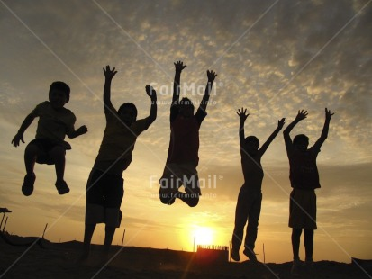 Fair Trade Photo Activity, Backlit, Beach, Colour image, Emotions, Friendship, Group of boys, Group of children, Happiness, Horizontal, Jumping, Outdoor, People, Peru, Playing, Sand, Silhouette, South America, Sun, Sunset, Together