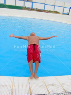 Fair Trade Photo Activity, Blue, Jumping, One boy, Outdoor, People, Peru, Playing, Red, South America, Summer, Swimming, Vertical, Water