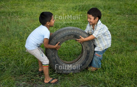 Fair Trade Photo Activity, Casual clothing, Clothing, Colour image, Cooperation, Day, Emotions, Friendship, Grass, Happiness, Horizontal, Outdoor, People, Peru, Playing, Rural, South America, Two boys