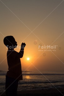 Fair Trade Photo Activity, Colour image, Dreaming, Evening, One boy, Outdoor, People, Peru, Playing, Soapbubble, South America, Spirituality, Sunset, Vertical
