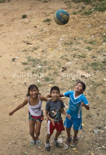 Fair Trade Photo Activity, Ball, Colour image, Emotions, Friendship, Group of children, Happiness, People, Peru, Playing, Rural, Smiling, South America, Together, Vertical