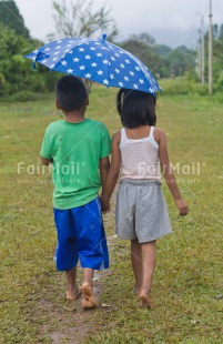 Fair Trade Photo Activity, Colour image, Cute, Friendship, Grass, Horizontal, People, Peru, Rural, South America, Together, Two children, Umbrella, Vertical, Walking