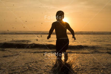 Fair Trade Photo Activity, Colour image, Horizontal, One boy, People, Peru, Playing, Sea, Shooting style, Silhouette, South America, Sunset