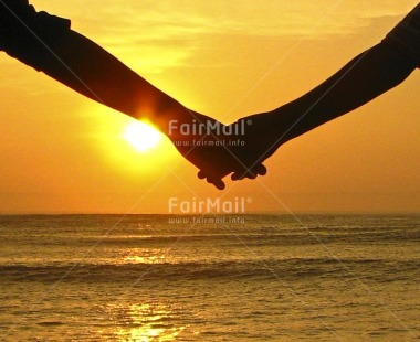 Fair Trade Photo Colour image, Evening, Hand, Horizontal, Love, Marriage, Outdoor, Peru, Sea, Seasons, South America, Summer, Sun, Sunset, Together, Valentines day, Water