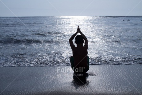 Fair Trade Photo 10-15_years, Activity, Backlit, Beach, Colour image, Evening, Horizontal, One boy, Outdoor, People, Peru, Sea, Silhouette, South America, Sunset, Water, Yoga