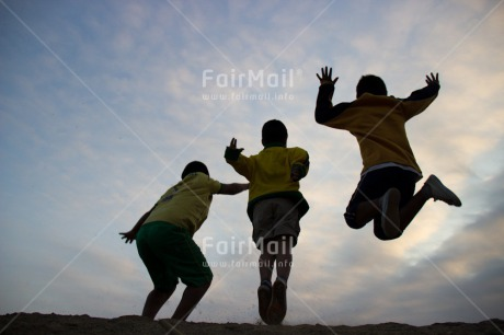Fair Trade Photo Activity, Backlit, Casual clothing, Clothing, Colour image, Cooperation, Emotions, Evening, Friendship, Group of boys, Happiness, Jumping, Outdoor, People, Peru, Playing, Silhouette, South America, Sport, Together