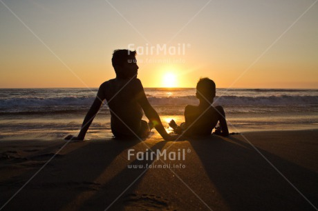 Fair Trade Photo Activity, Beach, Brother, Colour image, Colourful, Emotions, Evening, Friend, Friendship, Happiness, Horizontal, Light, Looking, Looking away, Outdoor, People, Peru, Relax, Relaxing, Sea, Shooting style, Silhouette, Sitting, Sky, South America, Sun, Sunset