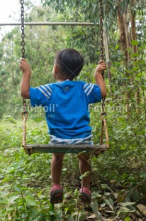 Fair Trade Photo Activity, Colour image, Emotions, Freedom, Happiness, Nature, One boy, Outdoor, People, Peru, Playing, South America, Swing, Vertical, Wellness