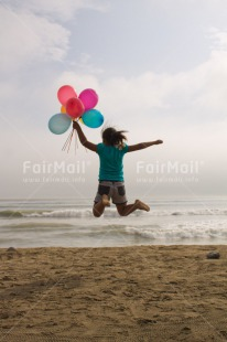Fair Trade Photo Activity, Balloon, Beach, Birthday, Celebrating, Child, Colour image, Day, Emotions, Friendship, Girl, Happiness, Holding, Holiday, Jumping, Multi-coloured, Ocean, Outdoor, People, Peru, Sand, Sea, Seasons, Sister, South America, Summer, Vertical, Water