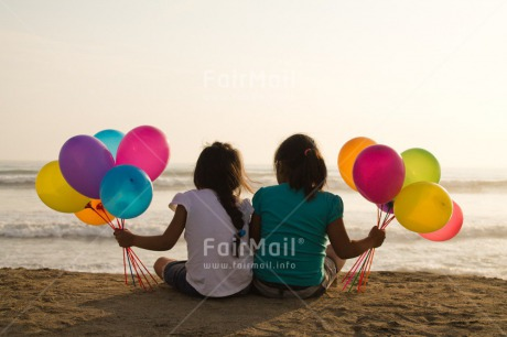 Fair Trade Photo Activity, Balloon, Beach, Birthday, Celebrating, Child, Colour image, Day, Emotions, Friendship, Girl, Happiness, Holding, Holiday, Horizontal, Multi-coloured, Ocean, Outdoor, People, Peru, Sand, Sea, Seasons, Sister, Sitting, South America, Summer, Water