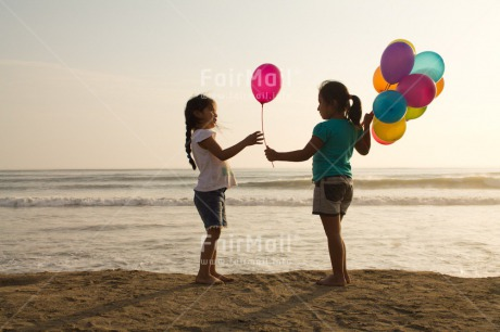 Fair Trade Photo Activity, Balloon, Beach, Birthday, Celebrating, Child, Colour image, Day, Emotions, Friendship, Gift, Girl, Happiness, Holding, Holiday, Horizontal, Multi-coloured, Ocean, Outdoor, People, Peru, Sand, Sea, Seasons, Sister, South America, Standing, Summer, Water