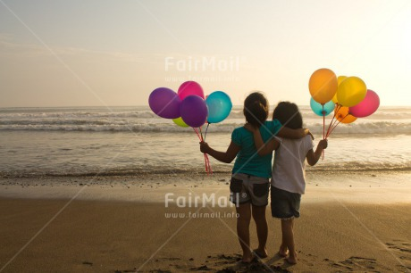 Fair Trade Photo Activity, Balloon, Beach, Birthday, Celebrating, Child, Colour image, Day, Emotions, Friendship, Girl, Happiness, Holding, Holiday, Horizontal, Multi-coloured, Ocean, Outdoor, People, Peru, Sand, Sea, Seasons, Sister, South America, Standing, Summer, Water