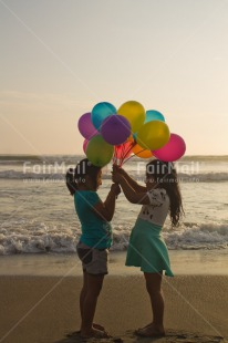 Fair Trade Photo Activity, Balloon, Beach, Birthday, Celebrating, Child, Colour image, Day, Emotions, Friendship, Gift, Girl, Happiness, Holding, Holiday, Multi-coloured, Ocean, Outdoor, People, Peru, Sand, Sea, Seasons, Sister, South America, Standing, Summer, Vertical, Water