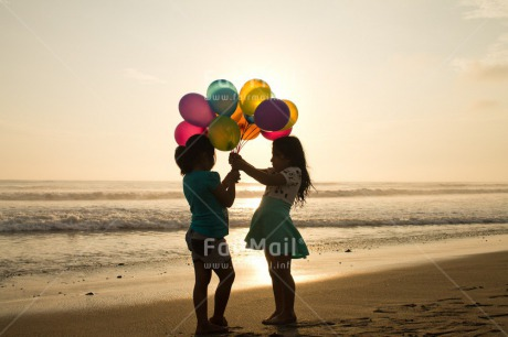 Fair Trade Photo Activity, Balloon, Beach, Birthday, Celebrating, Child, Colour image, Day, Emotions, Evening, Friendship, Gift, Girl, Happiness, Holding, Holiday, Horizontal, Multi-coloured, Ocean, Outdoor, People, Peru, Sand, Sea, Seasons, Sister, South America, Standing, Summer, Sunset, Water
