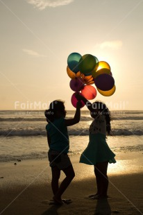 Fair Trade Photo Activity, Balloon, Beach, Birthday, Celebrating, Child, Colour image, Day, Emotions, Evening, Friendship, Gift, Girl, Happiness, Holding, Holiday, Multi-coloured, Ocean, Outdoor, People, Peru, Sand, Sea, Seasons, Sister, South America, Standing, Summer, Sunset, Vertical, Water