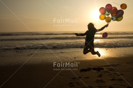Fair Trade Photo Activity, Balloon, Beach, Birthday, Celebrating, Child, Colour image, Day, Emotions, Evening, Friendship, Girl, Happiness, Holding, Holiday, Horizontal, Jumping, Multi-coloured, Ocean, Outdoor, People, Peru, Sand, Sea, Seasons, Sister, South America, Summer, Sunset, Water
