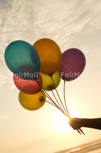 Fair Trade Photo Activity, Balloon, Beach, Birthday, Celebrating, Colour image, Day, Evening, Gift, Holding, Multi-coloured, Ocean, Outdoor, Peru, Sea, South America, Sunset, Vertical, Water