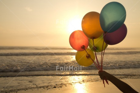 Fair Trade Photo Activity, Balloon, Beach, Birthday, Celebrating, Colour image, Day, Evening, Gift, Holding, Horizontal, Multi-coloured, Ocean, Outdoor, Peru, Sea, South America, Sunset, Water
