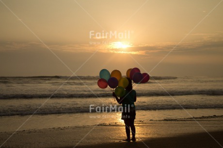 Fair Trade Photo Activity, Balloon, Beach, Birthday, Celebrating, Child, Colour image, Day, Emotions, Evening, Friendship, Girl, Happiness, Holding, Holiday, Horizontal, Multi-coloured, Ocean, Outdoor, People, Peru, Sand, Sea, Seasons, Sister, South America, Standing, Summer, Sunset, Water