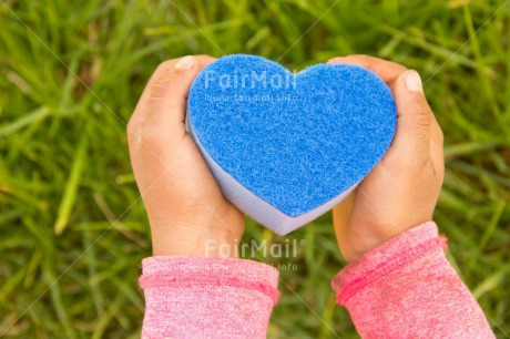 Fair Trade Photo Blue, Child, Colour image, Day, Fathers day, Girl, Grass, Green, Hands, Heart, Horizontal, Love, Mothers day, Nature, Outdoor, People, Peru, South America, Valentines day