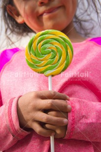 Fair Trade Photo Birthday, Colour image, Day, Emotions, Girl, Hands, Happiness, Latin, Lollipop, Outdoor, People, Peru, Pink, Smile, Smiling, South America, Sweets, Vertical