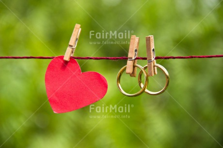 Fair Trade Photo Colour image, Couple, Gold, Green, Hanging, Heart, Horizontal, Love, Marriage, Nature, Outdoor, Peg, Peru, Red, Ring, South America, Together, Two, Wedding